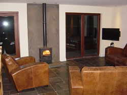 The wood burner, widescreen television and comfortabe seats