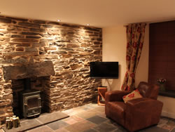 Kingston lodge - sitting room with stone wall