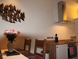 Kingston lodge in Orkney - dining table and kitchen